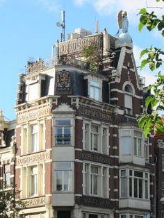 building with an angel on top, 1843, history not described - Haarlemmerstraat 2, Amsterdam