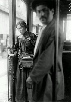 Women in France filled all sorts of men's jobs during WWI.  A tram conductor in Paris, 1917.