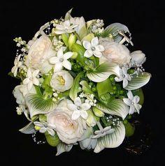 White Freesia, White Roses, White Stephanotis, White Lily Of The Valley, Green/White Lady's Slipper Orchids, Green Hypericum Berries