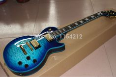 2014 Wholesale Custom shop electric guitar with Tiger Flame blue binding and Gold hardware ** Click image to review more details.
