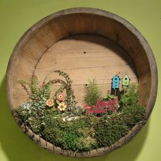 Wall-mounted mini garden in the bottom of a barrel featuring our Studio M Gypsy Garden line! -Maura