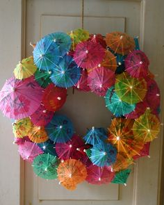 What an awesome idea. A cocktail umbrella wreath!