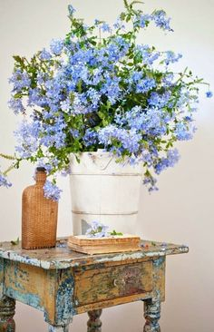 side table flowing with cornflower blue posies