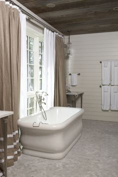 plank ceiling, horizontal plank walls, vanities separated by window  (designed by Tracery Interiors)