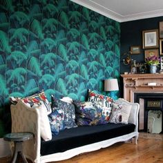 Our customer @ZoeNorfolkPhotography has used Cole & Son's 'Palm Jungle' as her accent wall with Farrow & Ball's 'Railings' on the chimney breast and 'Blue Grey' on the walls. www.cole-and-son.com