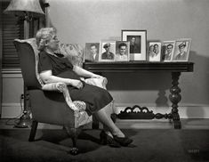 """Spring 1942. New Bedford, Massachusetts. """"Portuguese mother with pictures of her sons, who are all in service."""" Photo by John Collier, OWI."""