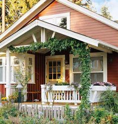 Classic Cottage Porch Planter boxes, climbing vines, and comfortable seating on this porch brings the garden into the house.