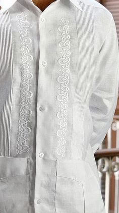 Embroidered rounded Guayabera for Wedding. Made by GCubanas - Premium Hight Quality Italian Linen Guayabera. Guayabera style. Mexican tucks. These Mexican wedding shirts  are long sleeves. Button cuff. Dry Clean for best result. A classic an sublimely soft  Linen 100 %. Availability is subject to change Manufacture in Mexico By GuayaberasCubanas. Just call us for Grooms wedding colors.  Take 2 -3 weeks.