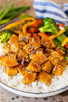 This teriyaki chicken bowl recipe is diced chicken, colorful vegetables and steamed rice served with a homemade teriyaki sauce.