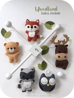 Made to order (current turnaround time is 10-12 business days). This crib mobile is a perfect decorative piece for your nursery or baby shower/new baby gift. •INCLUDES• 1 Wooden frame 1 Fox plushie 1 Raccoon plushie 1 Bear plushie 1 Owl plushie 1 Moose plushie Small embelishments Made with high quality eco-friendly felt. The design is originally made by me, Angeline. I hand-cut, hand-sew each item with lots of love. Pet & smoke free home. The wood hangers are also handcrafted with the sam...
