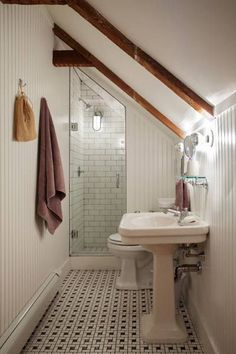 Narrow Attic Bathroom. www.rilane.com - I like the idea of adding the wood panels!