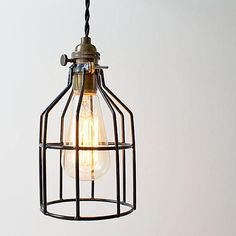 """These handcrafted caged pendant lights bring a warm vintage aesthetic into your living space.  Hang several in a row Dimensions 9.5"""" x 5"""""""