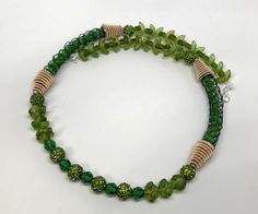 Sections of knit 24 gauge Artistic Wire and coiled cones add a touch of pizzazz to this fun Pantone inspired necklace.