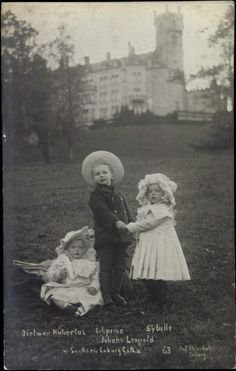 And then there were three. HP Johann Leopold and Princess Sibylla, standing, with baby brother Prince Hubertus, circa 1910.