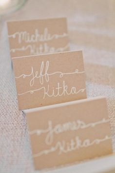white calligraphy and kraft paper place cards