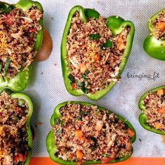 Stuffed Bell Peppers by @bringing_fit 1 cup uncooked quinoa (cook according to instructions) 3 chicken breasts (Google marinade for Chicken Fajitas by Giada DeLaurentiis), cooked and shredded 1 carrot, diced 1 celery stalk, diced 2 large handfuls spinach, julienned 1 can diced tomatoes 1 onion, diced 2 garlic cloves, minced 1 zucchini, diced 1/2 cup Corn* 1/2 cup black beans* 4-6 large bell peppers Cheddar cheese Salt & Pepper 1 tablespoon Italian herbs 1/2 tsp chili powder *i didn't add but…