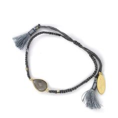 FEATHER & STONE Fini Friendship Bracelet in Grey ($47) ❤ liked on Polyvore featuring jewelry, bracelets, grey, feather jewelry, tassel jewelry, grey jewelry, stone jewelry and stone bangles