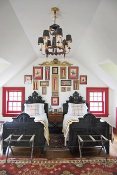 Love the gallery arrangement, chandalier and twin beds with luggage racks at foot.