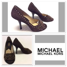 Brown suede studded Michael Kors pumps size 9M Beautiful brown suede pumps with gold studs and brown stones for detail. peep toe front and 4 inch heel height. Very little signs of wear to sole. They are in excellent used condition. Make them yours today! MICHAEL Michael Kors Shoes Heels