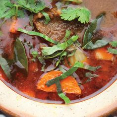 All Thai curries start with a handful of aromatic ingredients (chiles, galangal, lemongrass, turmeric, etc.) pounded into a paste with a granite mortar and pestle. The paste is then stirred into soups or stews (often with coconut milk), or used as the basis of sautéed dishes. Use a mini-processor to make the curry paste if you'd like, although this incendiary stew will take on a deeper flavor if you can use a granite mortar and pestle.
