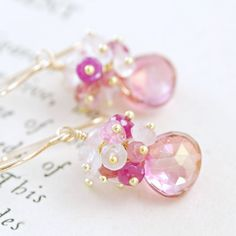 Pink Gemstone Cluster Earrings- Ive paired beautiful pink quartz briolettes with clusters of sparkling, faceted pink gemstone rondelles: sapphires, tourmaline, rose quartz, and more pink quartz. So pretty and feminine-- great for whenever you want to add a girly touch. Perfect for those who really like pink! Pink tourmaline is an October birthstone, so this makes a wonderful gift for someone with a birthday or anniversary in that month. Total length ~ 1 1/4 inches (3.2 cm) Quartz ~ 9 m...