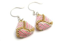 These softly colored earrings are bead woven peyote stitch triangle earrings in pink, silver, and gold. They are made with Japanese delica seed beads in an intricate knot pattern and finished with sterling silver round ear wires.  Lovely for a bridesmaid!  Approximately 3/4 inch diameter and length. They are light and comfortable to wear.  Free USA shipping and sent in a gift box.  Thanks for looking at my Etsy shop.
