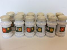 Vintage white milk glass spice bottles with colorful labels. Mid century shabby chic white milk glass spice jars. White glass spice jars. by Nostalgic4vintage on Etsy https://www.etsy.com/listing/287992169/vintage-white-milk-glass-spice-bottles