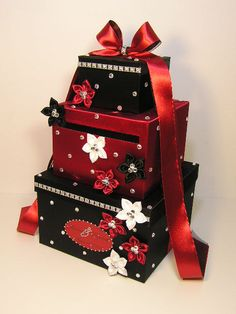 Three Tier Black and Red Wedding Card/Keepsake Box with Rhinestones and Red,Black and. White Ribbon Flowers and a Red Ribbon with Long Streamers on Top