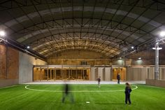 Built by COMOCO in Coimbra, Portugal with date Images by FG+SG - Fernando Guerra, Sergio Guerra. Our approach to the design of Indoor Sports Facility was determined twofold: on the one hand by the specif. Football Pitch, Football Field, Football Stadiums, Soccer Academy, Industrial Architecture, Contemporary Architecture, Industrial Interiors, Indoor Soccer, Indoor Gym