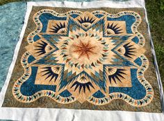 Paula's Glacier Star quilt.  Pattern by Judy Niemeyer.  Machine quilted by Kathleen Crabtree.