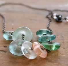 nine lives necklace. reminds me of seaglass and windswept shores.