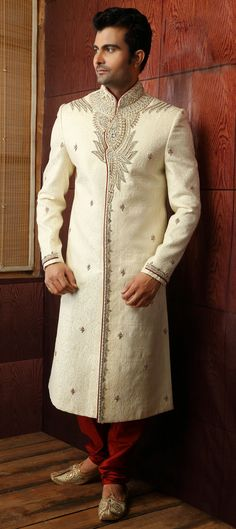 14859: White and Off White color family Sherwani. - Dee: The Sultan's first husband stood still while the photographers snapped pictures, looking grand in his long white tunic sparkling with cut crystals. The energy coming from the crystals were not overpowering.  Something, or somebody was in control of them. Then it stuck me as to why the Sultan was so interested in me enough to want a private audience - her first husband was an empath and possibly a truth-sayer.