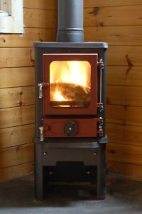 """Doesn't need brick or stone around it!  """"The Hobbit"""" wood stove."""