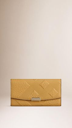 Saffron yellow Embossed Check Leather Continental Wallet - Image 1  Continental Wallet 4c0d4aa3598d9