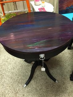 How's this for color? Unique lions paw table stained with vibrant, colorful…