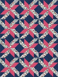 Our quilt kit is already pre-cut; no cutting for you. Quilt kit features beautiful Lily of the Valley and trumpet flowers in tones of pink, blue and plum along