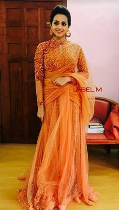 Bhavna in orange saree paired with beaded pearl work costume by label m Kerala Saree Blouse Designs, Half Saree Designs, Saree Blouse Patterns, Trendy Sarees, Fancy Sarees, Indian Wedding Gowns, Indian Dresses, Lehnga Dress, Lehenga