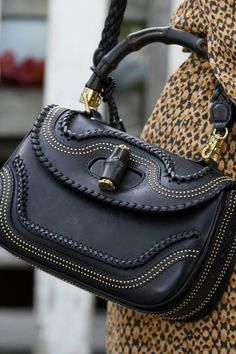Bamboo handle black leather bag with beautiful white stitch details. ing<3<3