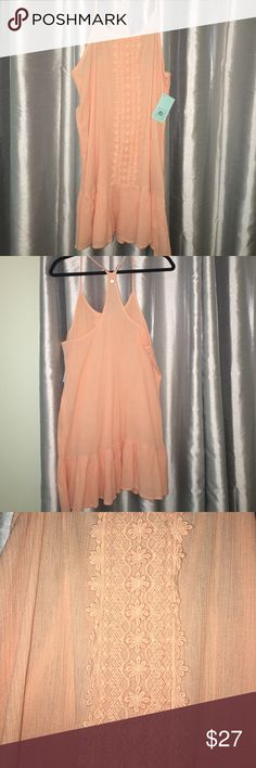 Rip Curt  NWT dress Rip Curl Dress with racer back and ruffle at bottom .  Fit 8-10.  31 inches from top strap to bottom Rip Curl Dresses Mini