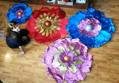 Giant paper flowers for school hall decoration. Metallic crepe paper, styrofoam center, acrylic paint, florist's fabric, hot glue.