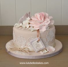 Pastel coloured elegant cake with edible roses and cake lace