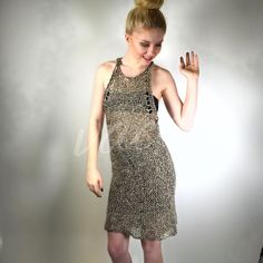 """Skaist Taylor Metallic Crochet Chain Mail Dress LA based Skaist Taylor (the two ladies who gave us Juicy Couture) crochet metallic gold/silver/black/white dress perfect for clubs, dancing, or a 3rd date. I call this """"the naked dress.""""  Model is wearing a black bandeau & mini underneath. Very light weight, very see through (resembles chainmail), very stretchy material - wool, metallic fiber. Apprx measurements laying flat: 11"""" wide, 31"""" long Please compare measurements to similar garment…"""