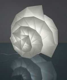 Coming soon to the US is a new line of origami influenced lamps created by fashion designer Issey Miyake for the Italian lighting company Artemide. Issey Miyake, Origami Design, Milan Furniture, Design Salon, Italian Lighting, Luminaire Design, Diffused Light, Recycle Plastic Bottles, Light And Shadow