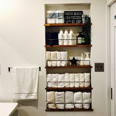 Hidden storage behind door for small bathroom. Pinning for picture only. Bathroom Organization, Bathroom Storage, Small Bathroom, Home Staging, Towel Storage, Towel Racks, Muji Storage, Hidden Storage, Home Remodeling