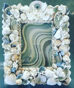 """""""#seashellpictureframe  Combination of seashells and  corals in white and blue colors looks great . :-)"""""""
