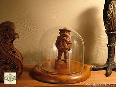 Love this little guy displayed in a small glass dome! Glass Dome Display, Glass Domes, The Bell Jar, Collectible Figurines, Nests, Skulls, Guy, Table Lamp, Base