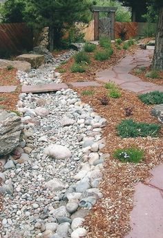Outdoor dry creek. This is how I could fix the creek beds in front yard. Put big rocks on outside of creek bed