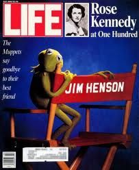 "[Image: A Life magazine cover featuring the Muppets character Kermit the Frog sitting on the armrest of a director's chair marked ""Jim Henson"" with the words beside him ""The Muppets say goodbye to."