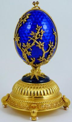 FABERGE FIREBIRD STERLING SILVER & ENAMEL EGG - Beautiful piece of work by the House of Carl Igor Faberge. Constructed of sterling silver and plated with 18K yellow gold. Inside surprise depicts a Firebird or Phoenix. This Piece is also a music box. #FabergeEgg #RussianAntiques #MusicBox