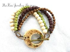 Cream, brown and Olive green ceramic clasp, metal and Czech Picasso glass bracelet. - McKee Jewelry Designs